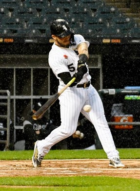 May 27, 2019; Chicago, IL, USA; Chicago White Sox second baseman Yolmer Sanchez (5) hits a one run single against the Kansas City Royals during the fifth inning at Guaranteed Rate Field. Mandatory Credit: David Banks-USA TODAY Sports