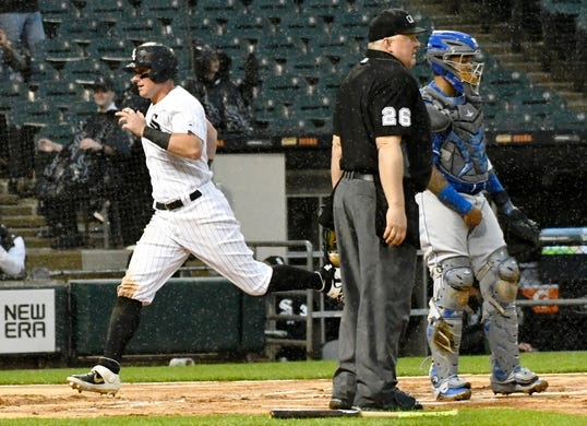 May 27, 2019; Chicago, IL, USA; Chicago White Sox catcher James McCann (33) scores against the Kansas City Royals during the fifth inning at Guaranteed Rate Field. Mandatory Credit: David Banks-USA TODAY Sports