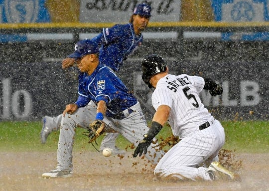 May 27, 2019; Chicago, IL, USA; Chicago White Sox second baseman Yolmer Sanchez (5) steals second base as Kansas City Royals second baseman Nicky Lopez (1) takes the throw during the fifth inning at Guaranteed Rate Field. Mandatory Credit: David Banks-USA TODAY Sports