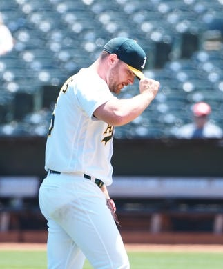 May 29, 2019; Oakland, CA, USA; Oakland Athletics starting pitcher Liam Hendriks (16) after loading the bases against the Los Angeles Angels during the first inning at Oakland Coliseum. Mandatory Credit: Kelley L Cox-USA TODAY Sports