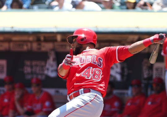 May 29, 2019; Oakland, CA, USA; Los Angeles Angels left fielder Cesar Puello (48) hits a two run RBI single against the Oakland Athletics during the first inning at Oakland Coliseum. Mandatory Credit: Kelley L Cox-USA TODAY Sports
