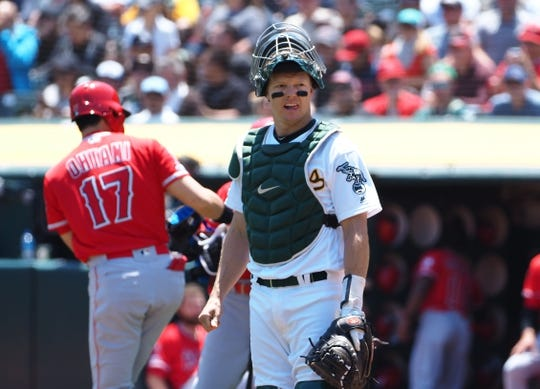 May 29, 2019; Oakland, CA, USA; Oakland Athletics catcher Nick Hundley (3) reacts after Los Angeles Angels designated hitter Shohei Ohtani (17) earns a walk during the first inning at Oakland Coliseum. Mandatory Credit: Kelley L Cox-USA TODAY Sports