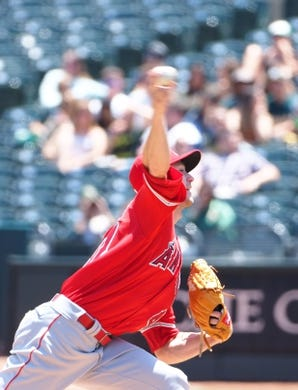 May 29, 2019; Oakland, CA, USA; Los Angeles Angels starting pitcher Griffin Canning (47) pitches the ball against the Oakland Athletics during the first inning at Oakland Coliseum. Mandatory Credit: Kelley L Cox-USA TODAY Sports