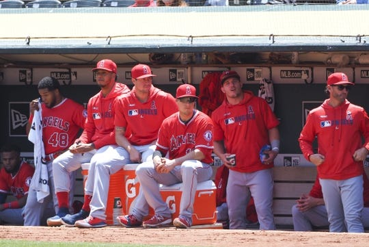 May 29, 2019; Oakland, CA, USA; Los Angeles Angels players in the dugout during the first inning against the Oakland Athletics at Oakland Coliseum. Mandatory Credit: Kelley L Cox-USA TODAY Sports