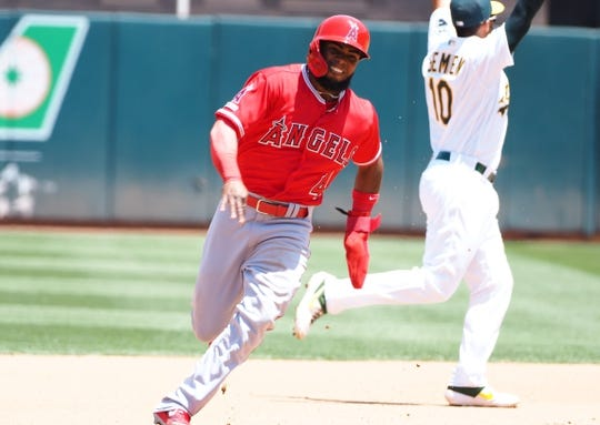 May 29, 2019; Oakland, CA, USA; Los Angeles Angels second baseman Luis Rengifo (4) rounds second base ahead of Oakland Athletics shortstop Marcus Semien (10) during the fourth inning at Oakland Coliseum. Mandatory Credit: Kelley L Cox-USA TODAY Sports
