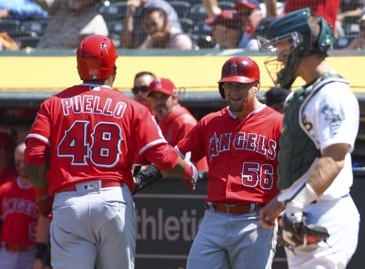 May 29, 2019; Oakland, CA, USA; Los Angeles Angels left fielder Cesar Puello (48) celebrates with right fielder Kole Calhoun (56) a two-run home run against the Oakland Athletics during the seventh inning at Oakland Coliseum. Mandatory Credit: Kelley L Cox-USA TODAY Sports
