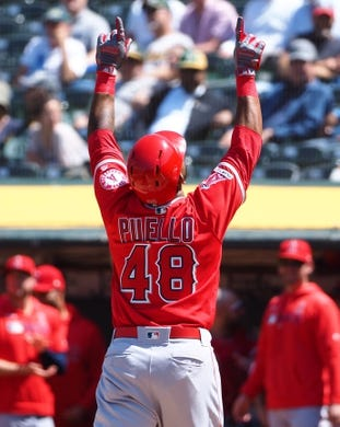 May 29, 2019; Oakland, CA, USA; Los Angeles Angels left fielder Cesar Puello (48) celebrates after hitting a two-run home run against the Oakland Athletics during the seventh inning at Oakland Coliseum. Mandatory Credit: Kelley L Cox-USA TODAY Sports