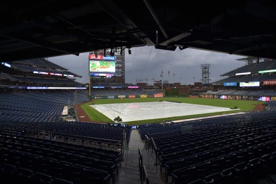 May 29, 2019; Philadelphia, PA, USA; A tarp cover the field during a rain delay before the game between the Philadelphia Phillies and the St. Louis Cardinals at Citizens Bank Park. Mandatory Credit: John Geliebter-USA TODAY Sports