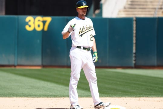 May 29, 2019; Oakland, CA, USA; Oakland Athletics right fielder Stephen Piscotty (25) gestures after a double against the Oakland Athletics during the seventh inning at Oakland Coliseum. Mandatory Credit: Kelley L Cox-USA TODAY Sports