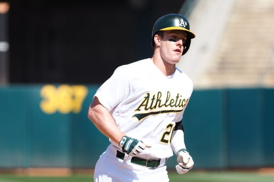 May 29, 2019; Oakland, CA, USA; Oakland Athletics designated hitter Mark Canha (20) rounds the bases on a solo home run against the Los Angeles Angels during the ninth inning at Oakland Coliseum. Mandatory Credit: Kelley L Cox-USA TODAY Sports