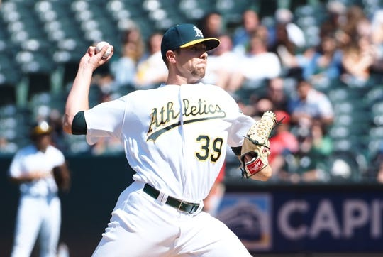 May 29, 2019; Oakland, CA, USA; Oakland Athletics relief pitcher Blake Treinen (39) pitches the ball against the Los Angeles Angels during the ninth inning at Oakland Coliseum. Mandatory Credit: Kelley L Cox-USA TODAY Sports