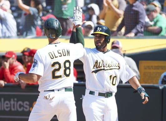 May 29, 2019; Oakland, CA, USA; Oakland Athletics first baseman Matt Olson (28) celebrates with shortstop Marcus Semien (10) after batting him in on a two-run home run against the Los Angeles Angels during the eighth inning at Oakland Coliseum. Mandatory Credit: Kelley L Cox-USA TODAY Sports