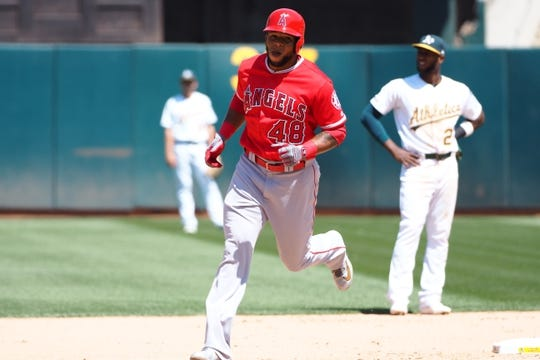 May 29, 2019; Oakland, CA, USA; Los Angeles Angels left fielder Cesar Puello (48) rounds the bases on a two-run home run against the Oakland Athletics during the seventh inning at Oakland Coliseum. Mandatory Credit: Kelley L Cox-USA TODAY Sports