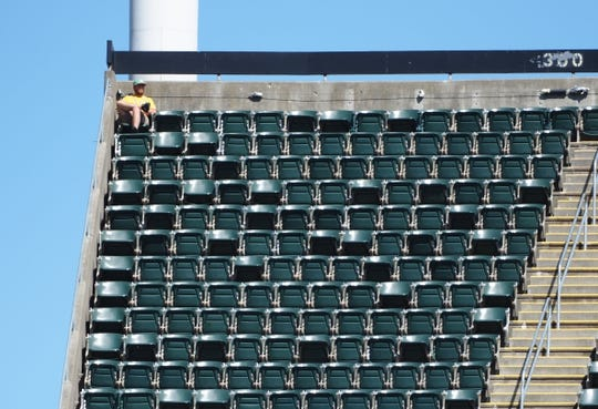 May 29, 2019; Oakland, CA, USA; An Oakland Athletics fan in the top corner of the bleachers during the ninth inning against the Los Angeles Angels at Oakland Coliseum. Mandatory Credit: Kelley L Cox-USA TODAY Sports