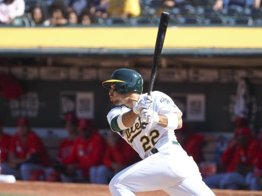 May 29, 2019; Oakland, CA, USA; Oakland Athletics center fielder Ramon Laureano (22) hits a single against the Los Angeles Angels during the ninth inning at Oakland Coliseum. Mandatory Credit: Kelley L Cox-USA TODAY Sports