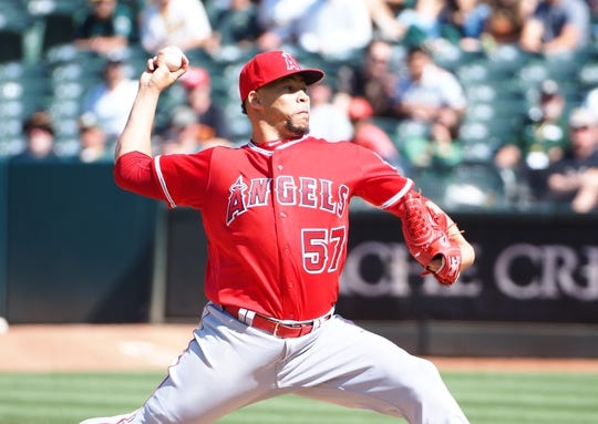 May 29, 2019; Oakland, CA, USA; Los Angeles Angels relief pitcher Hansel Robles (57) pitches the ball against the Oakland Athletics during the ninth inning at Oakland Coliseum. Mandatory Credit: Kelley L Cox-USA TODAY Sports