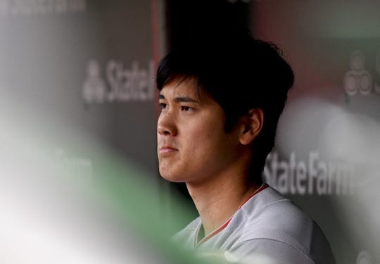Jun 3, 2019; Chicago, IL, USA; Los Angeles Angels designated hitter Shohei Ohtani (17) looks on from the dugout delivers against the Chicago Cubs in the second inning at Wrigley Field. Mandatory Credit: Matt Marton-USA TODAY Sports