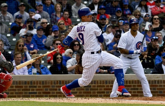 Jun 3, 2019; Chicago, IL, USA; Chicago Cubs shortstop Javier Baez (9) hits an RBI single in the fourth inning against the Los Angeles Angels at Wrigley Field. Mandatory Credit: Matt Marton-USA TODAY Sports