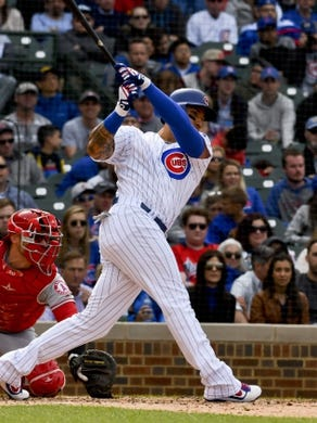 Jun 3, 2019; Chicago, IL, USA; Chicago Cubs right fielder Carlos Gonzalez (2) hits a single in the fourth inning against the Los Angeles Angels at Wrigley Field. Mandatory Credit: Matt Marton-USA TODAY Sports
