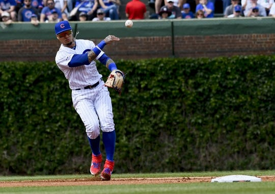 Jun 3, 2019; Chicago, IL, USA; Chicago Cubs shortstop Javier Baez (9) throws out Los Angeles Angels catcher Jonathan Lucroy (20) in the second inning at Wrigley Field. Mandatory Credit: Matt Marton-USA TODAY Sports