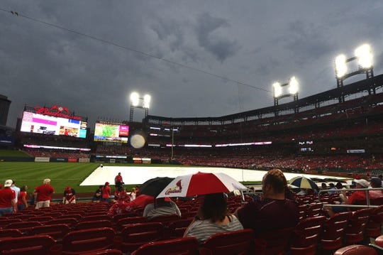 Jun 4, 2019; St. Louis, MO, USA; A general view as fans watch the tarp being placed on the field as storms move in prior to a game between the St. Louis Cardinals and the Cincinnati Reds at Busch Stadium. Mandatory Credit: Jeff Curry-USA TODAY Sports