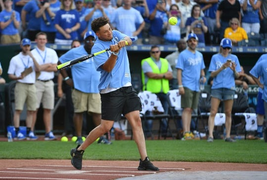 Jun 7, 2019; Kansas City, MO, USA; Kansas City Chiefs quarterback Patrick Mahomes hits a home run during the Big Slick celebrity softball game at Kauffman Stadium. Mandatory Credit: Denny Medley-USA TODAY Sports