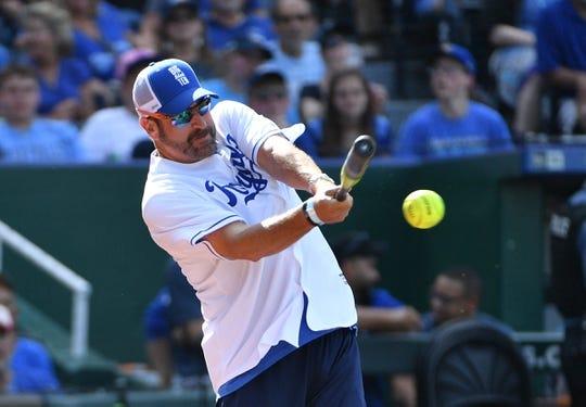 Jun 7, 2019; Kansas City, MO, USA; Actor and comedian Rob Riggle bats during the Big Slick celebrity softball game at Kauffman Stadium. Mandatory Credit: Denny Medley-USA TODAY Sports