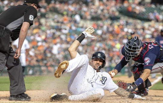 Jun 8, 2019; Detroit, MI, USA; Detroit Tigers right fielder Nicholas Castellanos (9) slides home and beats the tag by Minnesota Twins catcher Jason Castro (15) during the fifth inning of the game at Comerica Park. Mandatory Credit: Leon Halip-USA TODAY Sports
