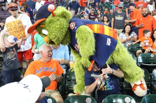 """Jun 9, 2019; Houston, TX, USA; Houston Astros mascot \""""Orbit\"""" steps over a fan before the Astros played against the Baltimore Orioles at Minute Maid Park. Mandatory Credit: Thomas B. Shea-USA TODAY Sports"""