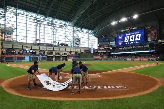 Jun 9, 2019; Houston, TX, USA; The grounds crew prepares the home plate area before the Houston Astros played against the Baltimore Orioles at Minute Maid Park. Mandatory Credit: Thomas B. Shea-USA TODAY Sports