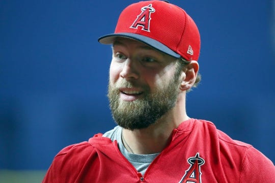 Jun 13, 2019; St. Petersburg, FL, USA; Los Angeles Angels catcher Kevan Smith (44) works out prior to the game against the Tampa Bay Rays at Tropicana Field. Mandatory Credit: Kim Klement-USA TODAY Sports