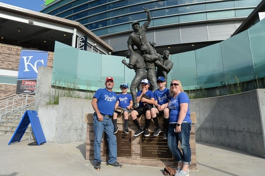 Jun 13, 2019; Omaha, NE, USA; Fans of the Kansas City Royals pose in front of the Road to Omaha statue before the game against the Detroit Tigers at TD Ameritrade Park Omaha. Mandatory Credit: Steven Branscombe-USA TODAY Sports