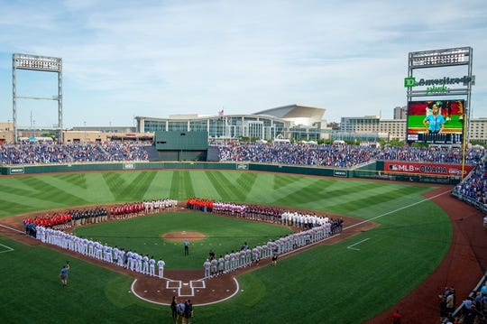 Jun 13, 2019; Omaha, NE, USA; The Kansas City Royals and the Detroit Tigers along with the eight teams participating in the College World Series stand for the national anthem before the game at TD Ameritrade Park Omaha. Mandatory Credit: Steven Branscombe-USA TODAY Sports
