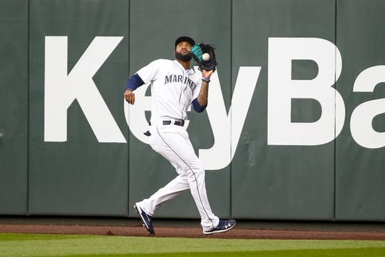 Jun 17, 2019; Seattle, WA, USA; Seattle Mariners right fielder Domingo Santana (16) catches a fly ball at the warning track against the Kansas City Royals during the third inning at T-Mobile Park. Mandatory Credit: Joe Nicholson-USA TODAY Sports