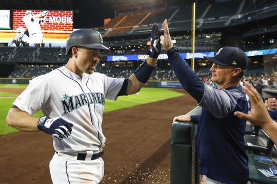 Jun 17, 2019; Seattle, WA, USA; Seattle Mariners catcher Tom Murphy (2) is greeted by manager Scott Servais (29) after hitting a three run home run against the Kansas City Royals during the fifth inning at T-Mobile Park. Mandatory Credit: Joe Nicholson-USA TODAY Sports