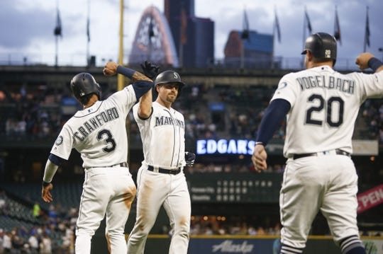 Jun 17, 2019; Seattle, WA, USA; Seattle Mariners catcher Tom Murphy (middle) celebrates outside the dugout after hitting a three run home run against the Kansas City Royals during the fifth inning at T-Mobile Park. Mandatory Credit: Joe Nicholson-USA TODAY Sports