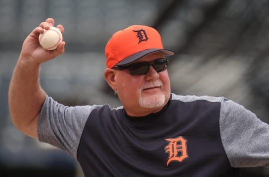 Jun 18, 2019; Pittsburgh, PA, USA;  Detroit Tigers manager Ron Gardenhire (15) plays catch on the field before the Pittsburgh Pirates host the Tigers at PNC Park. Mandatory Credit: Charles LeClaire-USA TODAY Sports