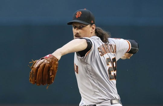 Jun 21, 2019; Phoenix, AZ, USA; San Francisco Giants starting pitcher Jeff Samardzija (29) throws against the Arizona Diamondbacks in the first inning during a baseball game at Chase Field. Mandatory Credit: Rick Scuteri-USA TODAY Sports