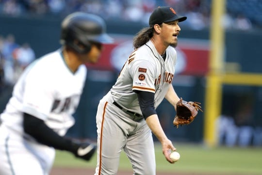 Jun 21, 2019; Phoenix, AZ, USA; San Francisco Giants starting pitcher Jeff Samardzija (29) flips the ball to firstbase for an out against the Arizona Diamondbacks in the first inning during a baseball game at Chase Field. Mandatory Credit: Rick Scuteri-USA TODAY Sports