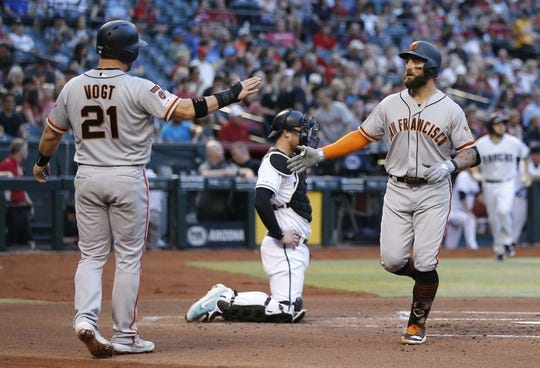 Jun 21, 2019; Phoenix, AZ, USA; San Francisco Giants center fielder Kevin Pillar (1) celebrates with Stephen Vogt (21) after hitting a two run homerun in the second inning against the Arizona Diamondbacks during a baseball game at Chase Field. Mandatory Credit: Rick Scuteri-USA TODAY Sports