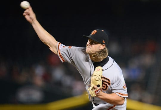 Jun 23, 2019; Phoenix, AZ, USA; San Francisco Giants starting pitcher Shaun Anderson (64) pitches against the Arizona Diamondbacks during the first inning at Chase Field. Mandatory Credit: Joe Camporeale-USA TODAY Sports