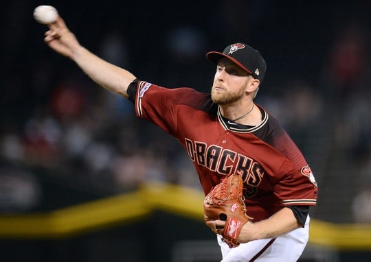 Jun 23, 2019; Phoenix, AZ, USA; Arizona Diamondbacks starting pitcher Merrill Kelly (29) pitches against the San Francisco Giants during the first inning at Chase Field. Mandatory Credit: Joe Camporeale-USA TODAY Sports