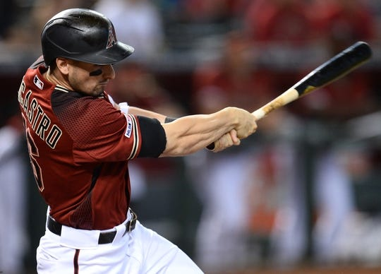 Jun 23, 2019; Phoenix, AZ, USA; Arizona Diamondbacks center fielder Tim Locastro (16) hits an RBI single against the San Francisco Giants during the third inning at Chase Field. Mandatory Credit: Joe Camporeale-USA TODAY Sports