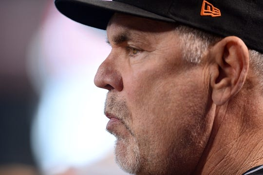 Jun 23, 2019; Phoenix, AZ, USA; San Francisco Giants manager Bruce Bochy (15) looks on against the Arizona Diamondbacks during the third inning at Chase Field. Mandatory Credit: Joe Camporeale-USA TODAY Sports