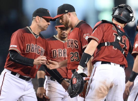 Jun 23, 2019; Phoenix, AZ, USA; Arizona Diamondbacks manager Torey Lovullo (17) removes Arizona Diamondbacks starting pitcher Merrill Kelly (29) from the game against the San Francisco Giants during the seventh inning at Chase Field. Mandatory Credit: Joe Camporeale-USA TODAY Sports