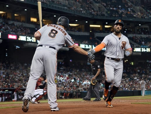 Jun 23, 2019; Phoenix, AZ, USA; San Francisco Giants center fielder Kevin Pillar (1) slaps hands with San Francisco Giants left fielder Alex Dickerson (8) after hitting a solo home run against the Arizona Diamondbacks during the seventh inning at Chase Field. Mandatory Credit: Joe Camporeale-USA TODAY Sports