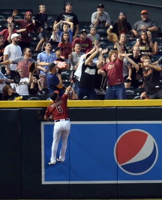 Jun 23, 2019; Phoenix, AZ, USA; Arizona Diamondbacks right fielder David Peralta (6) is unable to catch a home run ball hit by San Francisco Giants center fielder Kevin Pillar (not pictured) during the seventh inning at Chase Field. Mandatory Credit: Joe Camporeale-USA TODAY Sports
