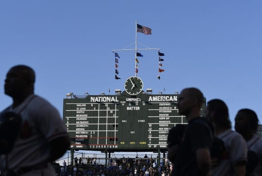 Jun 24, 2019; Chicago, IL, USA; The Atlanta Braves stand for the national anthem before the game against the Chicago Cubs at Wrigley Field. Mandatory Credit: David Banks-USA TODAY Sports