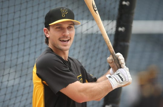 Jun 18, 2019; Pittsburgh, PA, USA;  Pittsburgh Pirates second baseman Adam Frazier (26) at the batting cage before playing h eDetroit Tigers at PNC Park. Detroit won 5-4. Mandatory Credit: Charles LeClaire-USA TODAY Sports