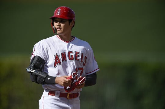 Jun 26, 2019; Anaheim, CA, USA; Los Angeles Angels designated hitter Shohei Ohtani (17) stands at first base after a single during the first inning against the Cincinnati Reds at Angel Stadium of Anaheim. Mandatory Credit: Kelvin Kuo-USA TODAY Sports